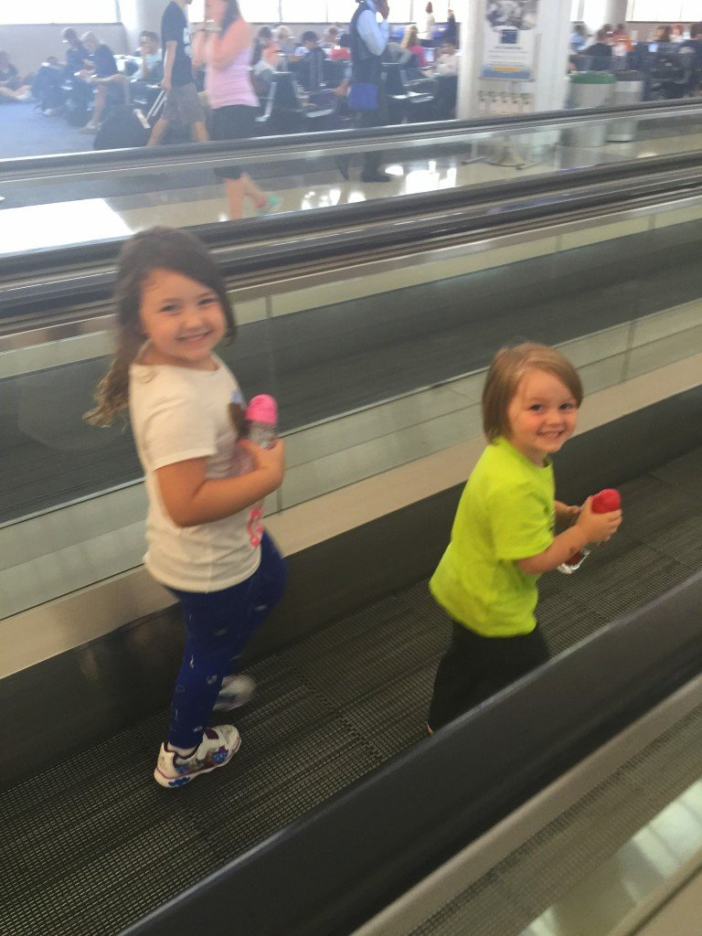 kids having fun in airport