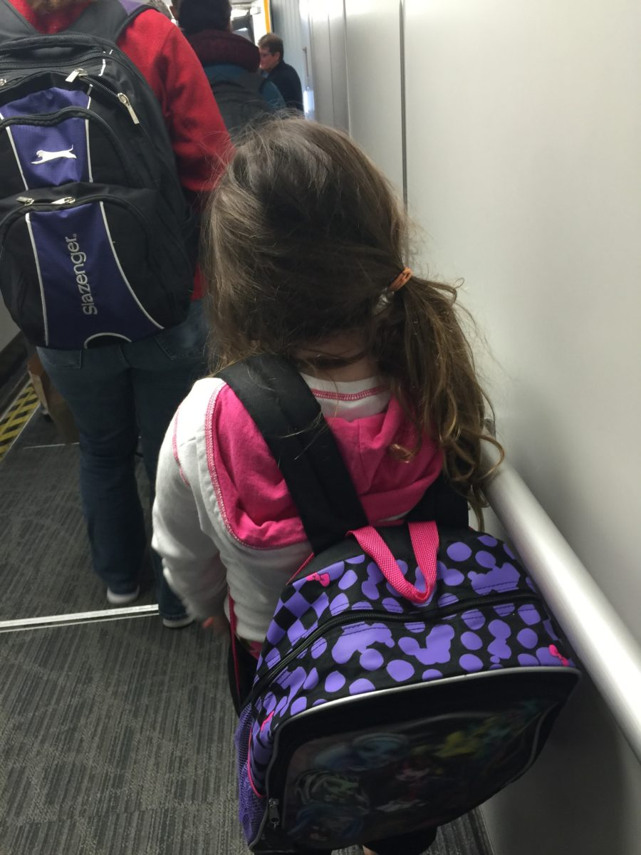 daughter boarding plane