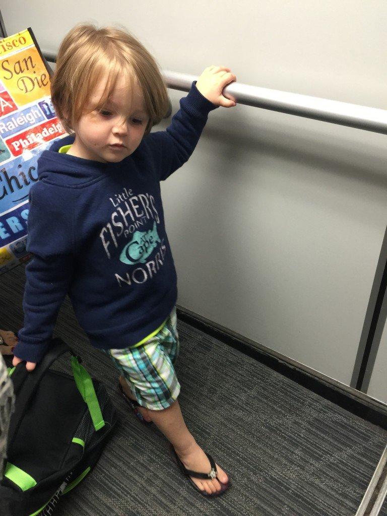 son boarding plane