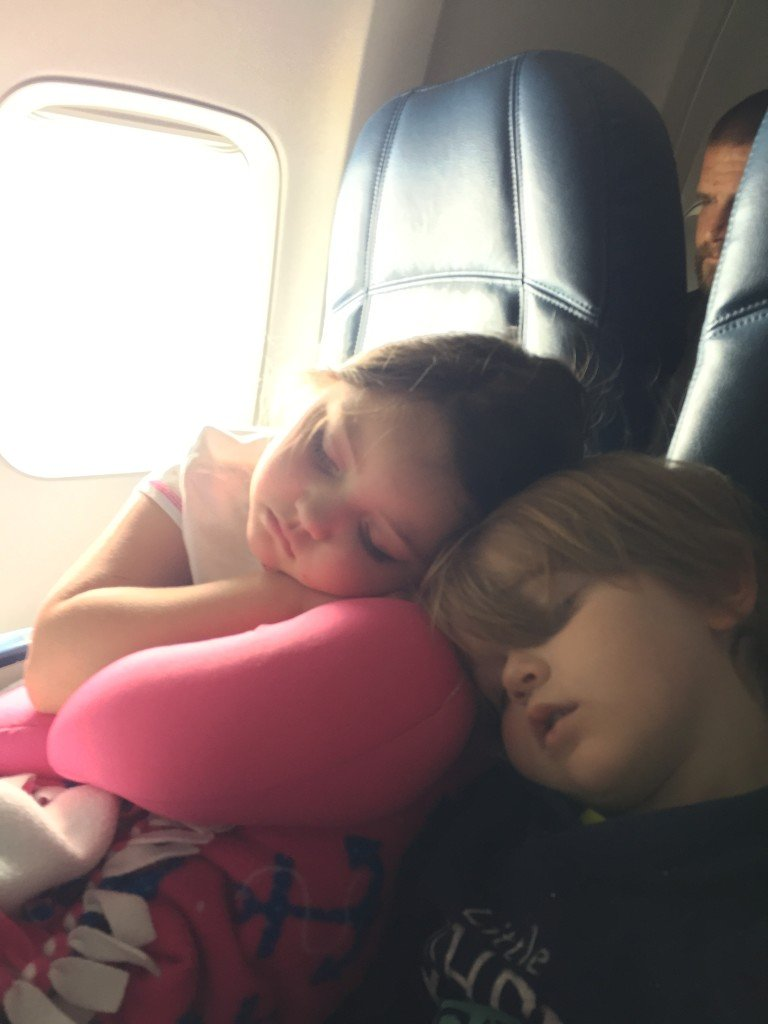 kids sleeping on airplane