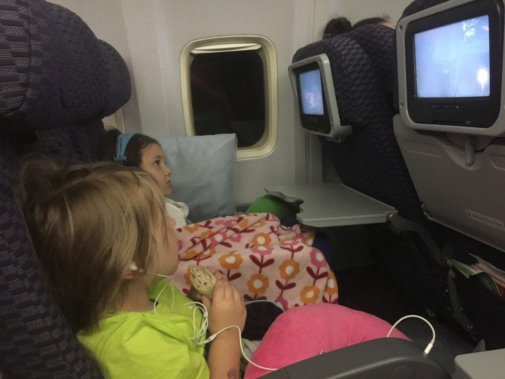 Flying with kids snacking on food