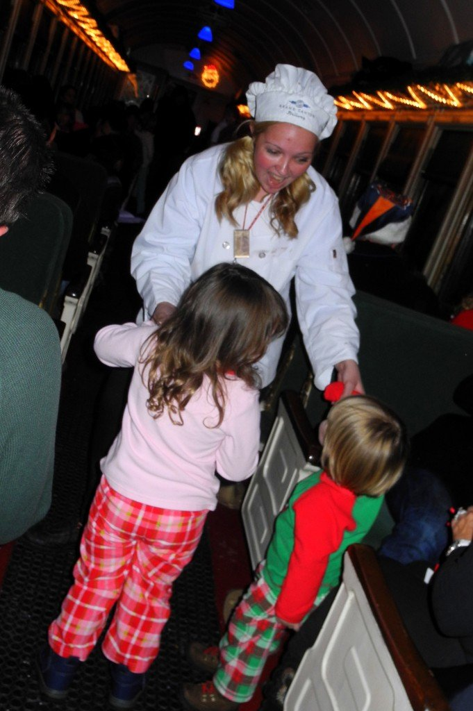 Staff dancing with kids on polar express