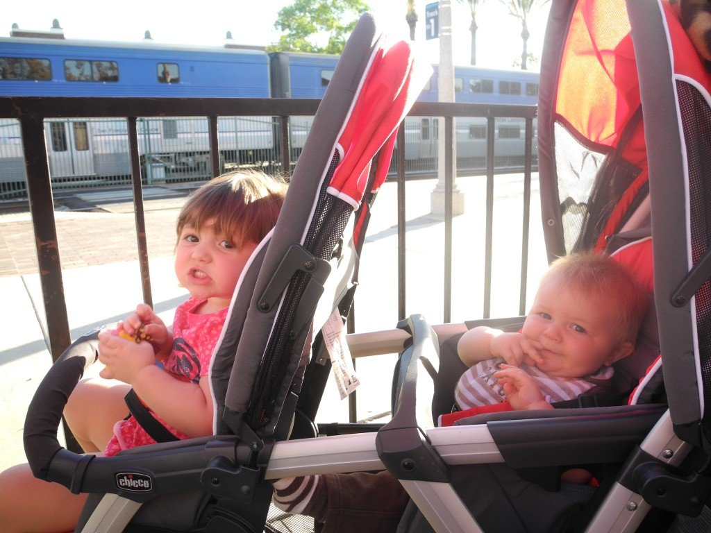 kids in stroller at train station