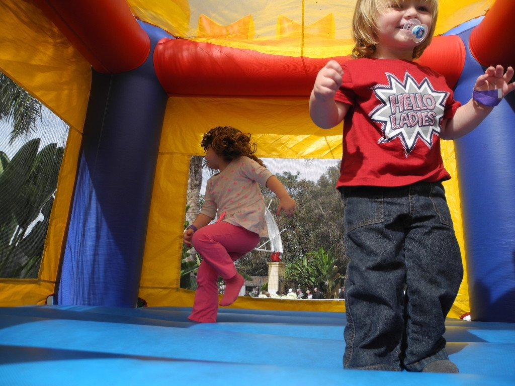 Kids in bounce house at Queen Mary Festival