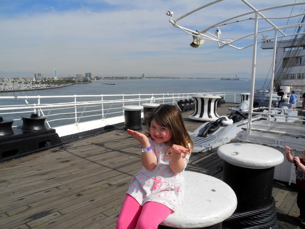 Little girl on deck of Queen Mary Cute