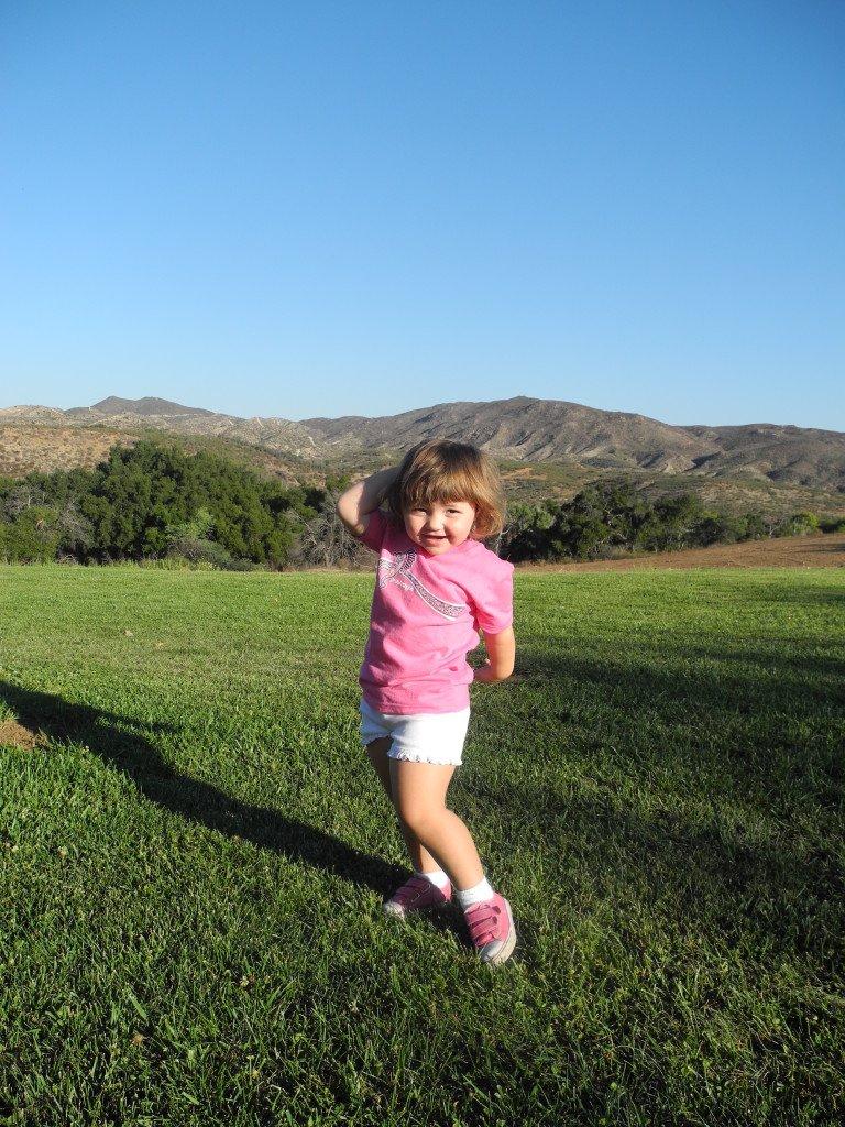 KId Playing in grass at Vail Lake Resort