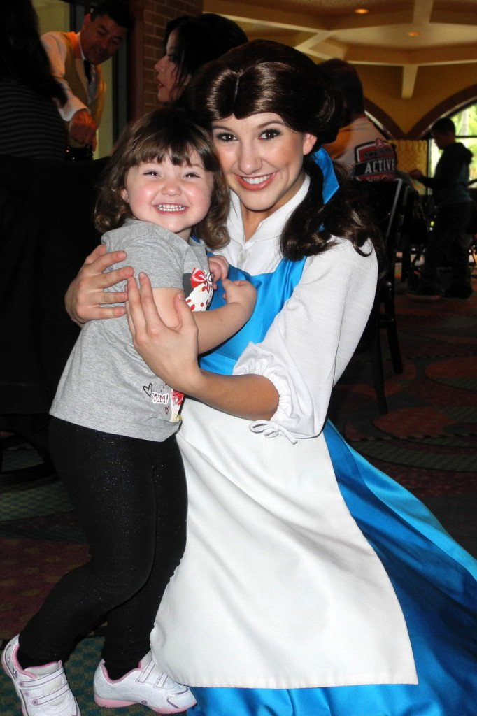 Little girl with Belle from Disney