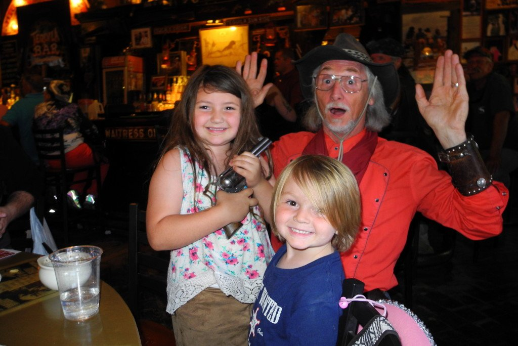 Tombstone with kids at big nose kates saloon