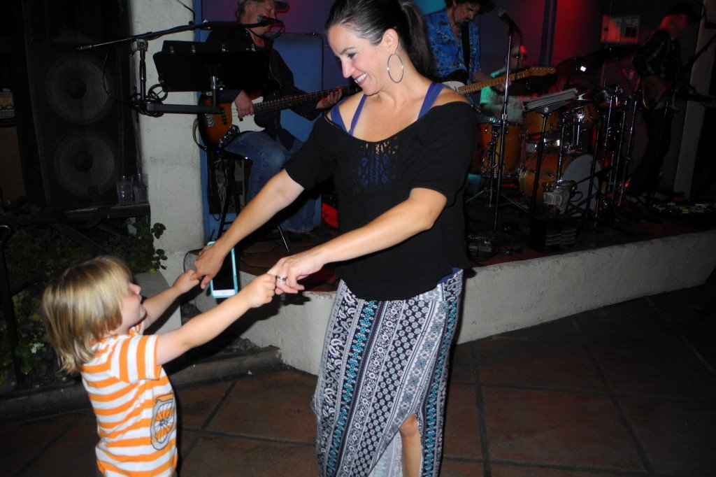 Mom dancing with kid at Las Casuelas Terraza Palm Springs