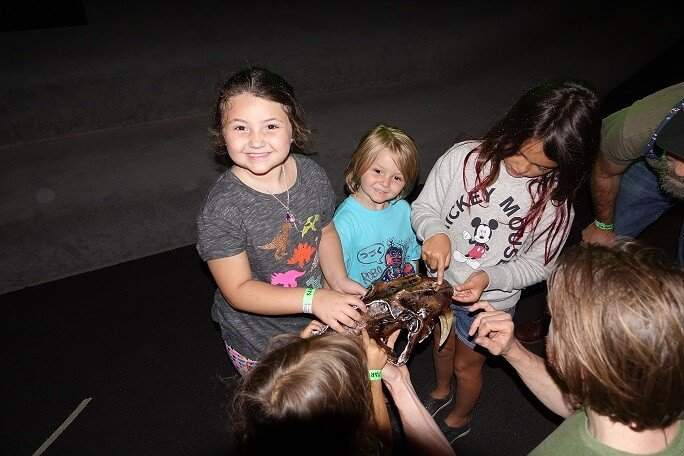 Kids touching fossils at La Brea Tar Pits
