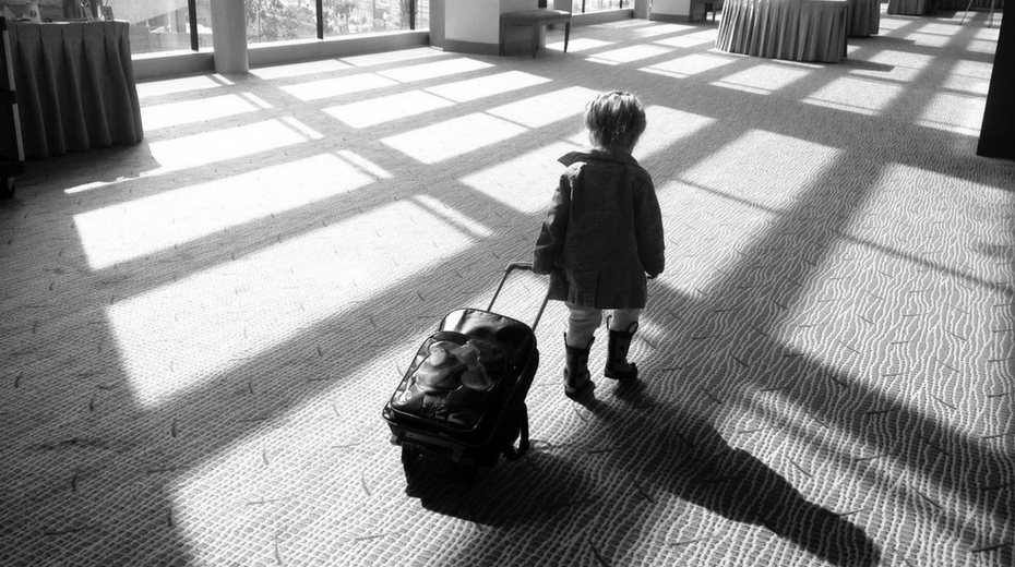 Child Rolling their Suitcase during Travel