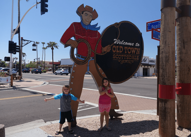 Kids in front of Old Town Scottsdale Cowboy Sign