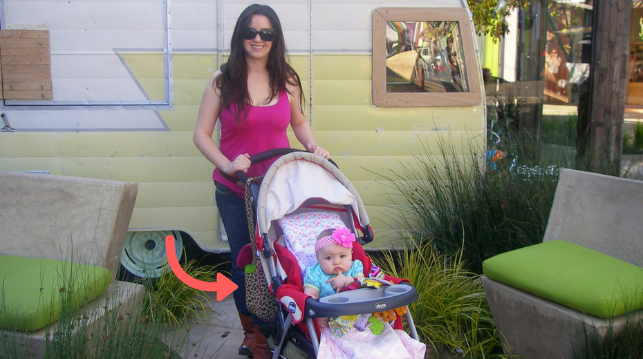 Mom with baby in stroller and leopard diaper bag